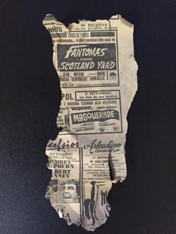Il misterioso ritaglio di giornale ritrovato nel risvolto dei pantaloni dell'uomo ucciso.